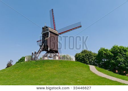 Wind mill and green lawn at Brugge