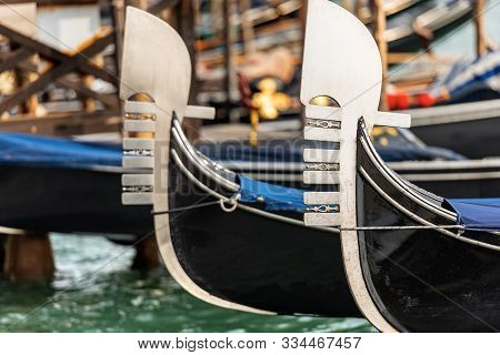 Venice, Detail Of Two Gondola Prows, Typical Venetian Rowboat, Canal Grande, Unesco World Heritage S