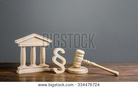 Courthouse, Gavel And A Paragraph Symbol. International Court. Protection Of Business Interests And