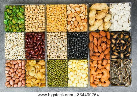 Box Of Different Whole Grains Beans And Legumes Seeds Lentils And Nuts Colorful Snack Texture Backgr