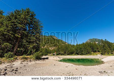 Lago del Predil, small mountain lake in Julian Alps, Tarvisio, Friuli Venezia Giulia, Italy, Europe poster
