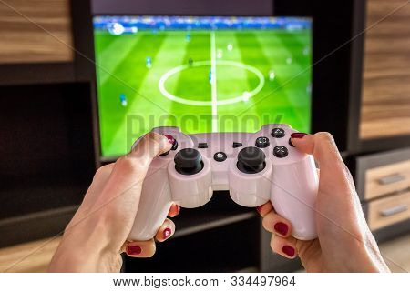 White Gaming Joystick, Gamepad, Standard Controller Is Aimed At The Tv, Pc Games Is On The Screen, C