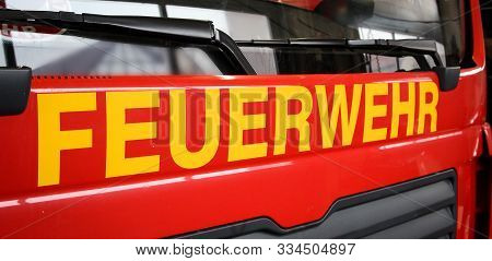 The Front Part Of A Fire Truck With The Lettering Fire Department