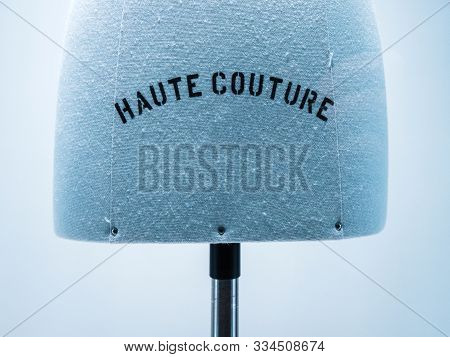 Haute Couture Signage On Mannequin Made From Fine Luxury Garment Textile In Luxury Fashion Store Ate
