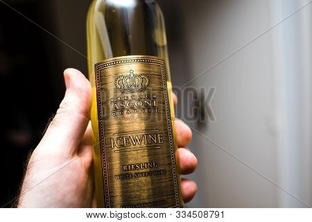 Paris, France - Jan 29, 2019: Man Hand Holding Asconi Ice Wine Riesling Manufactured In Moldova