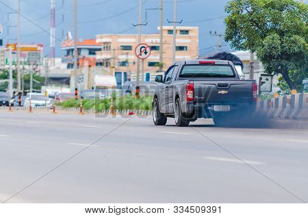 Samut Sakhon, Thailand - August 2019: Black Smoke From Exhaust Pipes Of Cars Running On The Rama Ii