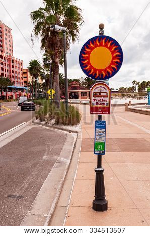 Clearwater Beach, Florida, Usa 11/6/19 A Trolley Stop Post Along South Gulfview Blvd On An Overcast