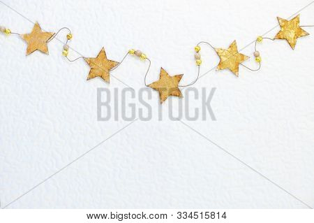 Yellow Stars On A String - Winter Holidays And New Year Eve Composition. Flat Lay, Top Down View Wit