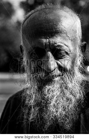 Homeless Man, Close Up Portrait Of Old Smiling Homeless Alcoholic Man Face With White Beard And Hair