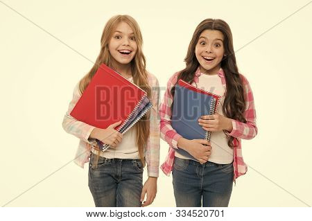 Back To School Books To Share. Little School Children Holding Note Books. Adorable Small Girls With