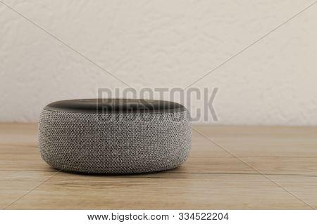 Aurich, Germany - November 09, 2019: Amazon Echo Dot On A Wooden Desktop. The Echo Dot Is A Hands Fr