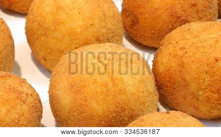 Many Big Balls Of Rice Called Arancini In Italian Language In The Gastronomy Shop