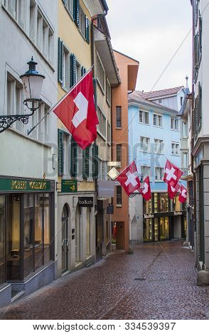 Zurich, Switzerland - May 10, 2018: Houses With Flags Of Switzerland In Zurich. Zurich Old Town. The