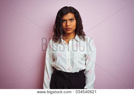 Transsexual transgender businesswoman standing over isolated pink background skeptic and nervous, frowning upset because of problem. Negative person.