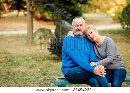Elderly Couple Walks In The Park. Happy Old Age.