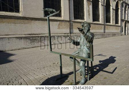 Brussels, Belgium - March 29, 2019: Memorial Bronze Statue Of Pieter Bruegel The Elder In The Old To