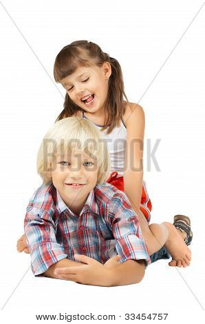 two little children sitting embrace and smile on white background isolated poster