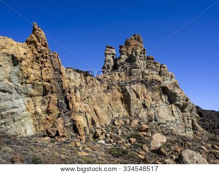 Rock Strata At Roques De Garcia In The Teide National Park In Tenerife, Canary Islands, Spain, With