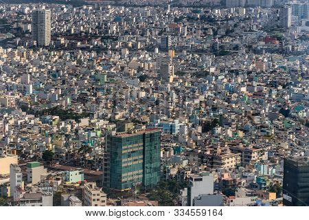 Ho Chi Minh City, Vietnam - March 12, 2019: Downtown. Dinh Le Green Tall Building In A Sea Of Lower