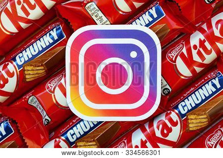 Instagram Paper Logo On Many Kit Kat Chocolate Covered Wafer Bars In Red Wrapping. Advertising Choco