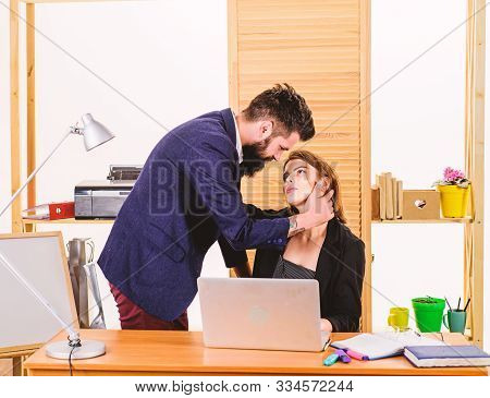 Couple Who Works Together. Couple Of Lovers At Workplace. Couple In Love Conducting Affair At Work.