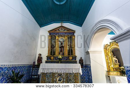 Lousa, Portugal - August 22, 2019: View Of The Main Altar Dedicated To St John The Evangelist Of The