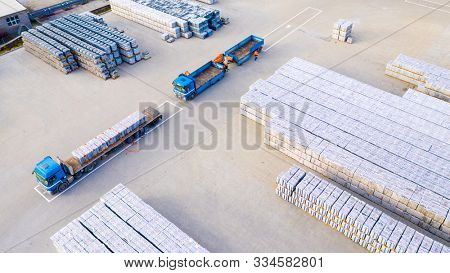 Pilsen / Czech Republic - November 18, 2019: Aerial view of warehouse with truck and forklift stacker . Industrial background. Logistics from above. Industry in European Union.