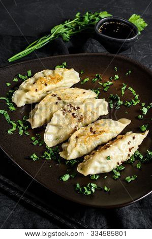 Pork Potstickers On Rustic Black Table. Dim Sum On A Plate. Top View.