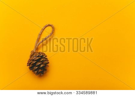 Christmas Decorative Cone On A Yellow Background. Festive Mood, Luxury Party, Winter Holidays, Craft