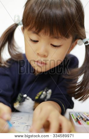 Japanese Girl Drawing A Coloring Book (4 Years Old)