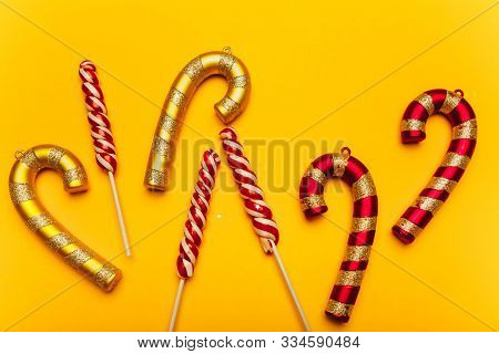 Golden And Red Frame-shaped Christmas Decorations On A Yellow Background. Festive Mood, Luxury Party
