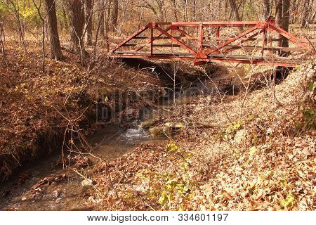 A Walking Bridge In Little Yellow Stone Park In Eastern North Dakota With A Fast Flowing Creek Under
