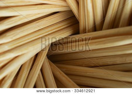 Brown Background Of Bamboo Toothpicks Close Up