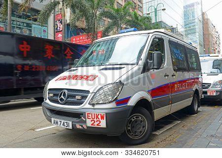 Hong Kong, China - Nov 10, 2015: Hong Kong Police Vehicle On Duty On Nathan Road In Kowloon, Hong Ko