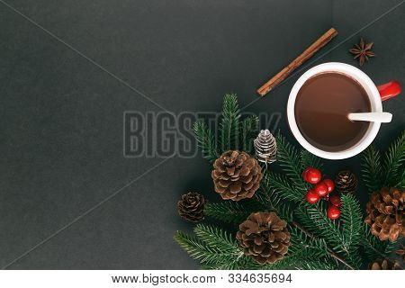 Christmas Black Granite Table Decorate Pine Leaf And Pine Cones, Holly Balls. Christmas Background W