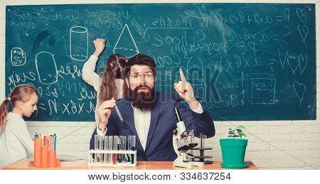 poster of Man bearded teacher work with microscope and test tubes in biology classroom. School teacher of biology. Explaining biology to children. Biology plays role in understanding of complex forms of life