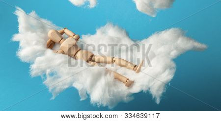 Comfortable Dream Of Toy Man On Clouds, Sweet Dreams. Rest On Bed.