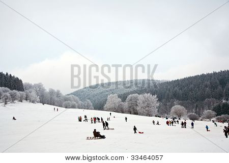 SCHMITTEN, GERMANY - DEC 10, 2008: children are skating at a toboggan run in winter on snow