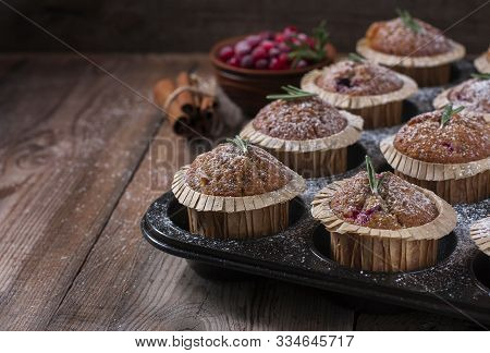 Fresh Homemade Cranberry Muffins In Baking Form On Wooden Table With Christmas Decoration. Muffins I