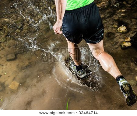 jogger running through water