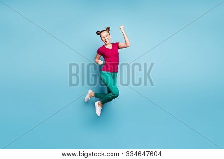 Full Length Body Size Turned Photo Of Excited Ecstatic Rejoicing Girl Wearing Red T-shirt Green Pant
