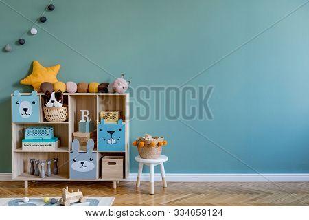 Stylish Scandinavian Newborn Baby Room With Wooden Cabinet, Toys, Children Chair, Natural Basket Mod