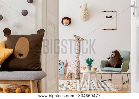 Modern And Design Scandinavian Interior Of Kidroom With Wooden Bench, Armachir, Mock Up Poster Frame