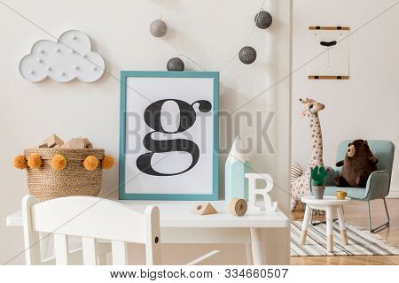 Modern And Design Scandinavian Interior Of Kidroom With White Desk, Armachirs, Mock Up Poster Frame,