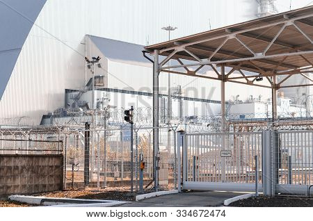 Building Nuclear Power Plant And Fencing With Video Surveillance In Chernobyl Ukraine