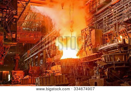 Melting Of Metal In A Steel Plant. High Temperature In The Melting Furnace
