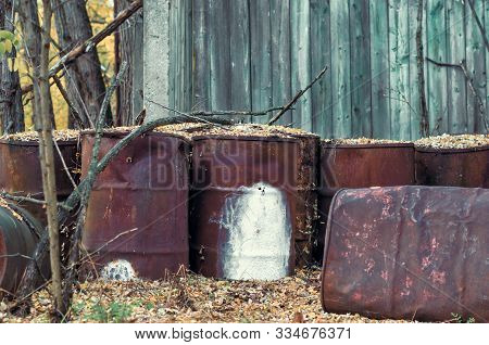 Old Barrels Of Chemical Waste And Chlorine In The Forest In Chernobyl Ukraine In Autumn