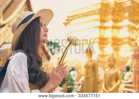 Woman Traveler Tourist Praying At Buddhist Temple. Journey Trip Travel Concept
