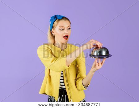 Presentation. Retro Woman Holds Metal Tray With Lid. Restaurant Serving. Waiter. Smiling Woman Holds