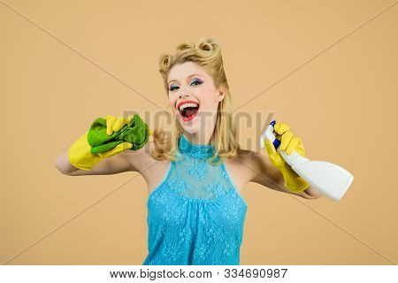 Cleaning service. Girl cleaning with rag and bottle spray. Cleanup. Cleaning tools. Beautiful woman holds duster and spray. Happy retro housewife. Housewife ready for housework. Cleaning pin up woman. poster